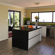 The interior and kitchen in a transportable home in NSW